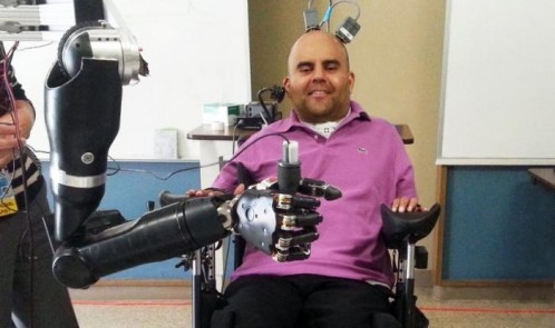 man-controlling-robotic-arm-with-mind