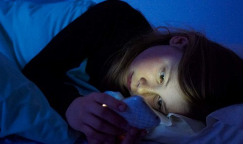 woman-cellphone-bed-nightime